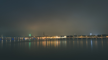 city light reflections over water at the night. Riga, Latvia - vintage look