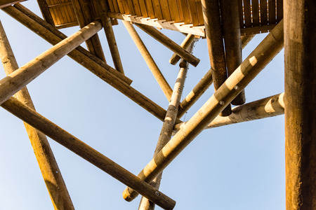 details of wooden watch tower deep in country forest with metal bolts