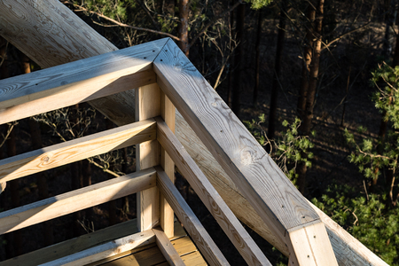 hunters tower: details of wooden watch tower deep in country forest with metal bolts