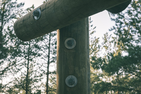 hunters tower: details of wooden watch tower deep in country forest with metal bolts - vintage green retro effect