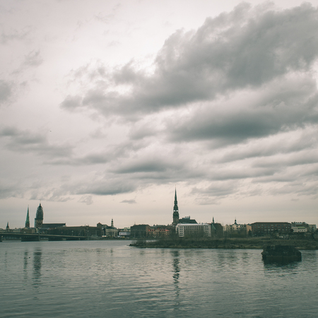 panoramic image of Riga shoreline with river Daugava and bridges, Riga, Latvia, april 15th 2015 - instant vintage square photo Stock Photo