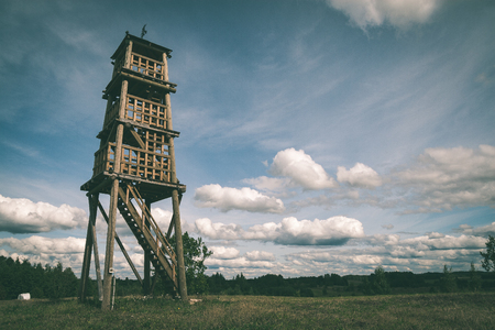 details of wooden watch tower deep in country forest with metal bolts - vintage green retro effect Stock Photo - 75223812