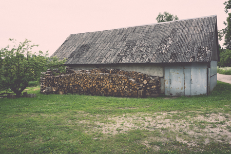 combustible: wooden log storage place for heating - vintage retro look Stock Photo
