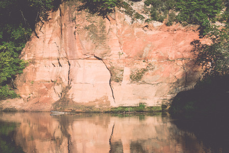 moab: river with reflections in weater and sandstone cliffs in latvia - retro, vintage style look Stock Photo
