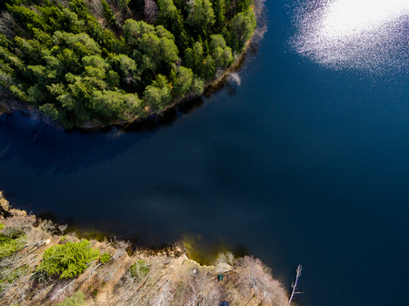 drone image. aerial view of rural area with forest lake in bright sunlight Stock Photo