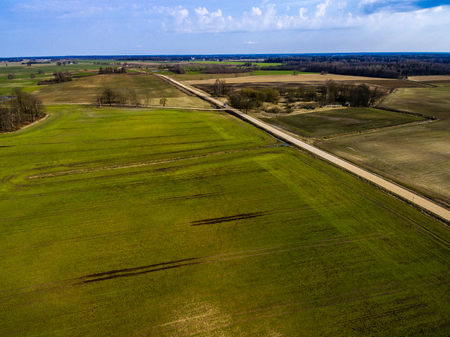 cleared: drone image. aerial view of rural area with freshly green fields, country roads and tractor tracks Stock Photo