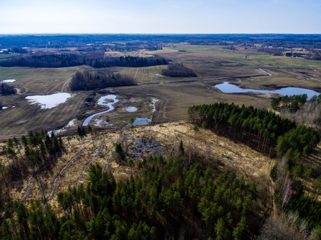 cleared: drone image. aerial view of rural area with forest lake in bright sunlight Stock Photo