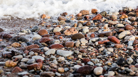 small pebble rock background texture at the beach