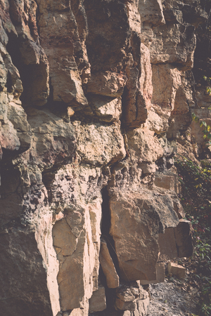 sandstone cliffs with water source. latvia. - retro, vintage style look Imagens