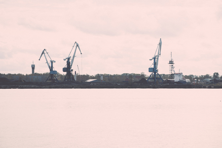 cargo dock and cargo ships in seaport in Riga. latvia - retro, vintage style look