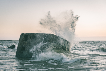 old war fort ruins on the beach with high waves in sunset. Liepaja, Latvia - vintage green look