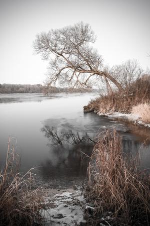 Beautiful winter landscape with frozen lake.. vintage retro monochrome look Stock Photo
