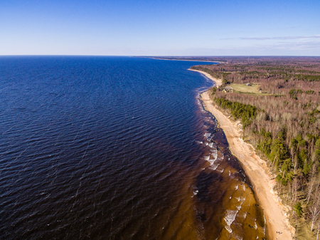 cleared: drone image. aerial view of baltic beach coast in sunny spring day. latvia