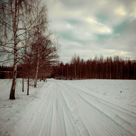 country snowy road in winter, rural area - retro vintage look