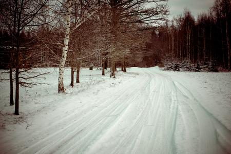 country snowy road in winter, rural area - retro vintage look