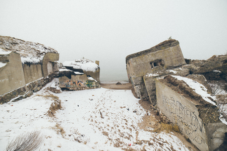 old war fort ruins on the beach in winter. Liepaja, Latvia- vintage film grain effect Stock Photo