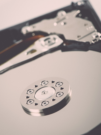 hard drive crash: computer hard disk drive close-up shot. shallow depth of field. macro - retro vintage effect Stock Photo