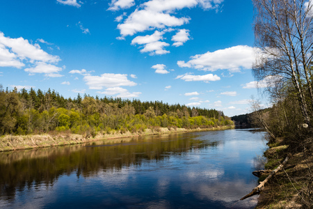 reflective: summer landscape of river with clouds and reflections