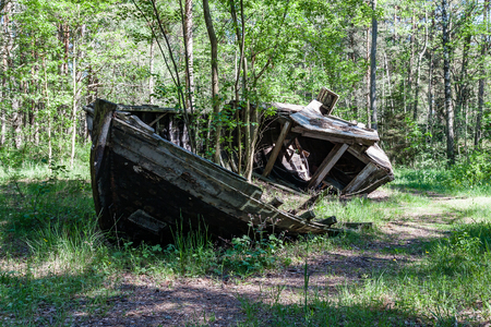 sinking: An old shipwreck or abandoned shipwreck. Wrecked boat abandoned stand on beach Stock Photo