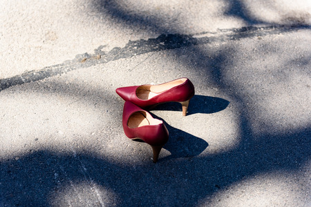 disposed: red shoes on the road