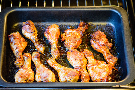 chicken wings cooking in oven in stove