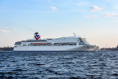 white sea ferry leaving the port of Riga in Latvia Stock Photo
