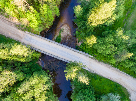 cleared: drone image. aerial view of rural area with forest river in summer morning Stock Photo