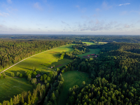 drone image. aerial view of rural area with forest river in summer morning Stock Photo