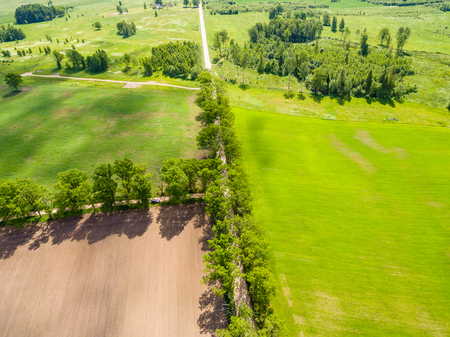 cultivated: drone image. aerial view of rural area with freshly cultivated fields. green and brown. summer