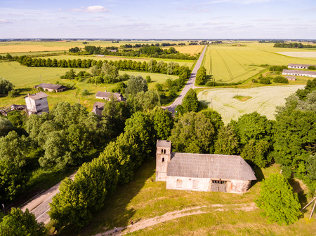 cleared: drone image. aerial view of rural area with old abandoned church building