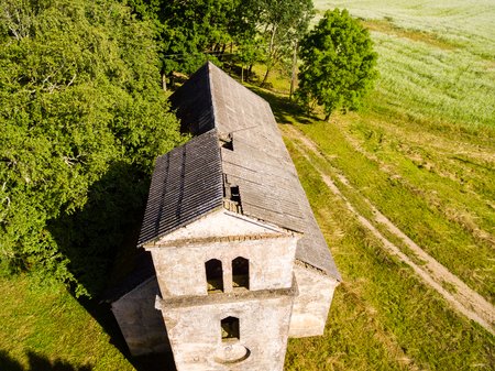 even: drone image. aerial view of rural area with old abandoned church building