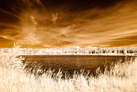 infrared camera image. colored. reflections of clouds in water in countryside