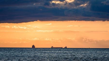 sea ships on the horizon in sunset near Riga, latvia