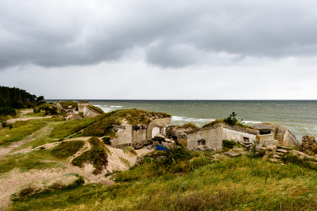 old war fort ruins on the beach with high waves in sunset. Liepaja, Latvia. storm aproaching Stock Photo