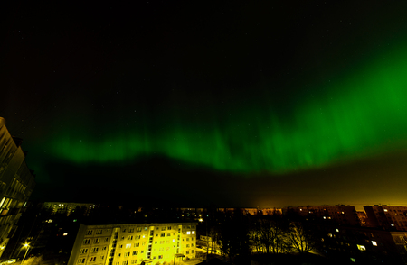 Intense northern lights (Aurora borealis) over city of Riga, Latvia.
