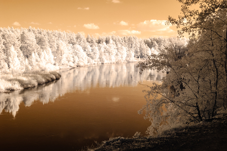 tourist trail by the river of Gauja in Valmiera Latvia. autumn colors in sunny day. infrared image Stock Photo
