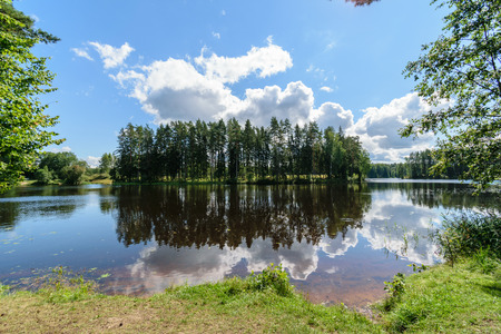 colorful lake river in countryside in summer. nature in latvia