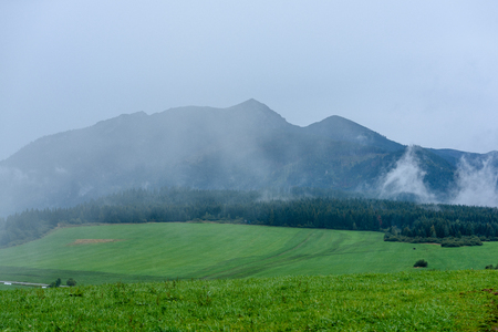 western carpathian mountain tops in  autumn covered in mist or clouds. panoramic view from a distance