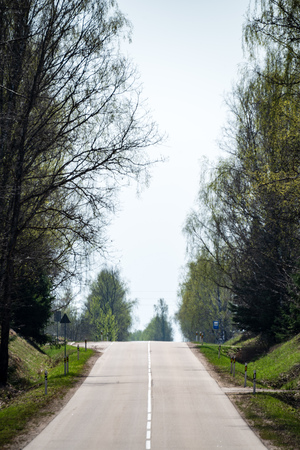 asphalt Road and the dramatic sky with strong perspective. latvia