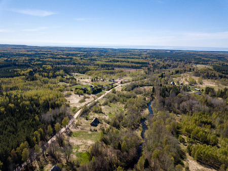 drone image. aerial view of rural area with river in forest from above. Latvia Banco de Imagens
