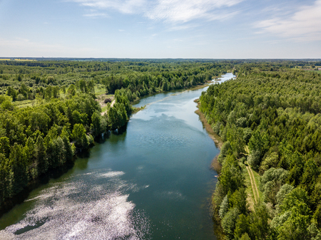 drone image. aerial view of rural area lake in forest with green water. latvia Stock Photo