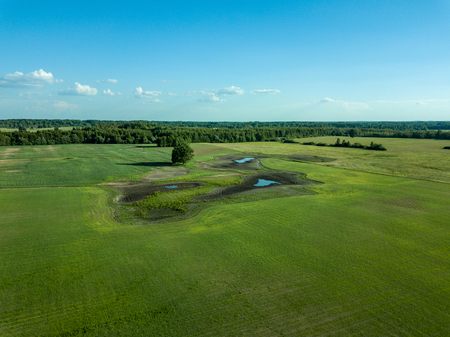 drone image. aerial view of empty cultivated fields  spring day. latvia