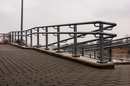 metal pedestrian bridge details in city of Bauska, Latvia. abstract texture and lines in cloudy spring day