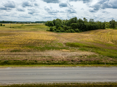 drone image. aerial view of rural area with fields and road network. latvia