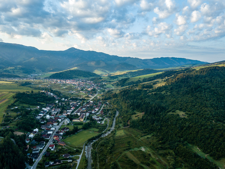 drone image. aerial view of rural mountain area in Slovakia, villages of Zuberec and Habovka from above. dramatic sunset over the mountain with clouds