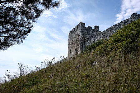 ruins of old abandoned castle on the cliff with bricks and stone. architecture details in Slovakia