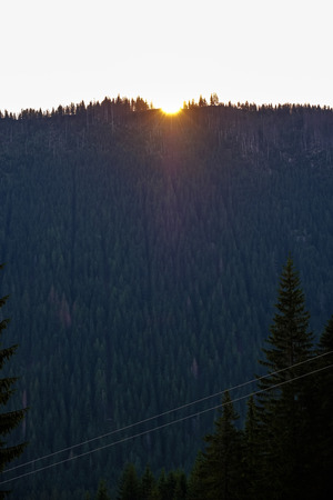morning light rising over the hill tops and forests in the mountains Tatra in Slovakia. first rays of light