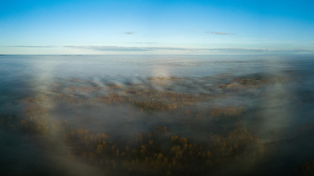 drone image. aerial view of rural area with sun halo above mist. high in the sky Reklamní fotografie