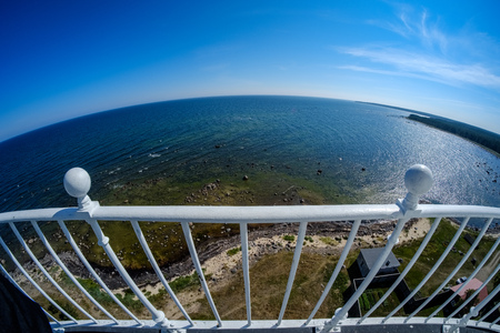fisheye lens view of the island of Hiiumaa in Estonia from lighthouse with white rails in clear day