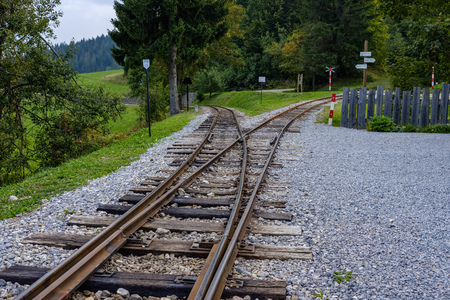 ancient log wood railway and train on the tracks. tourist attraction train in slovakia 免版税图像